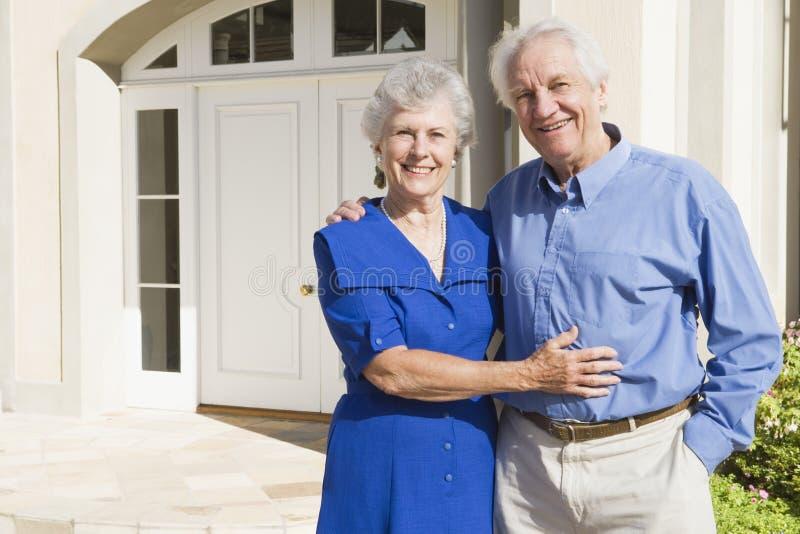 couple house outside senior