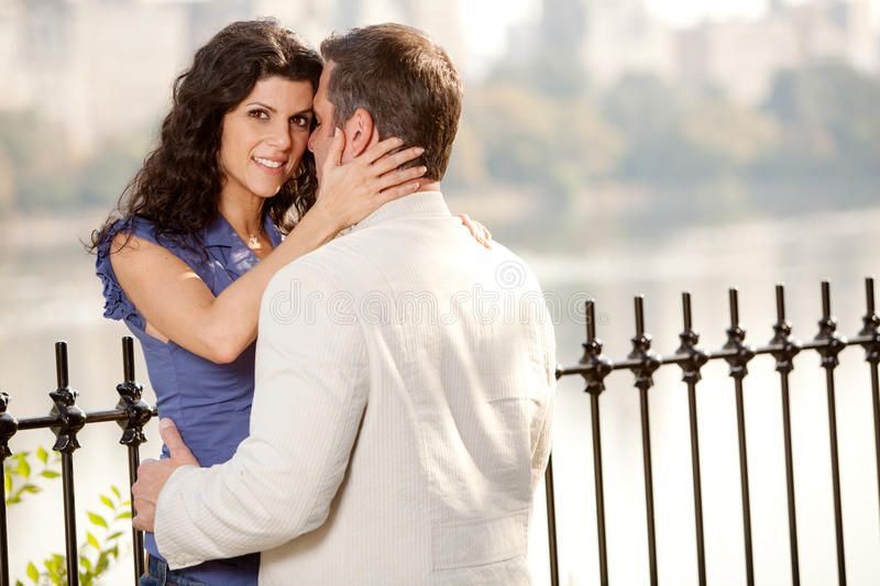 Couple Hug. A couple hugging in the park - eye contact with the female royalty free stock images