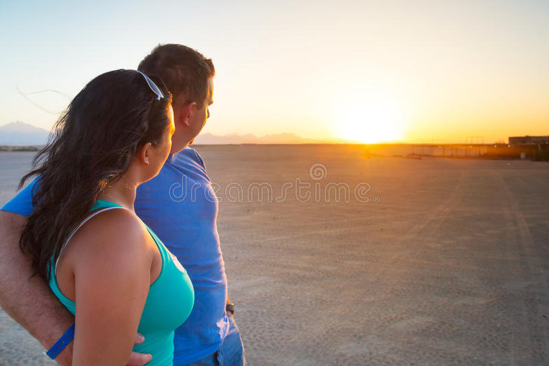 Couple In Hug Watching Together Sunset Royalty Free Stock Images