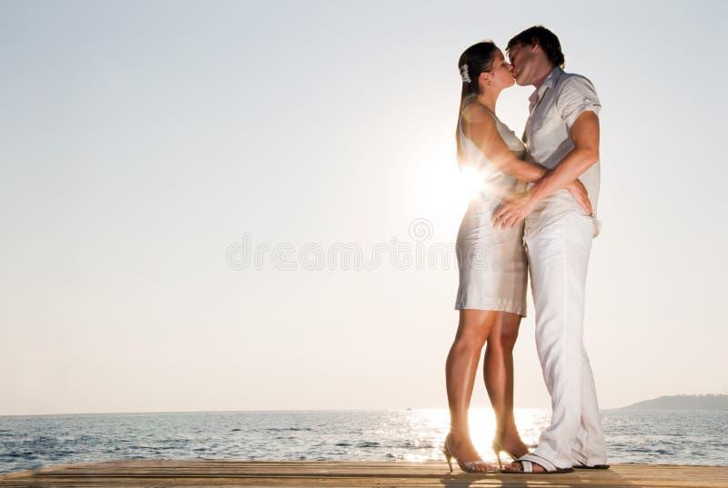 Couple hugging, enjoying summer sunset. Young Couple hugging, enjoying summer sunset stock photo