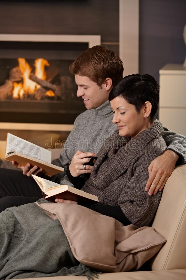 Couple hugging home stock images