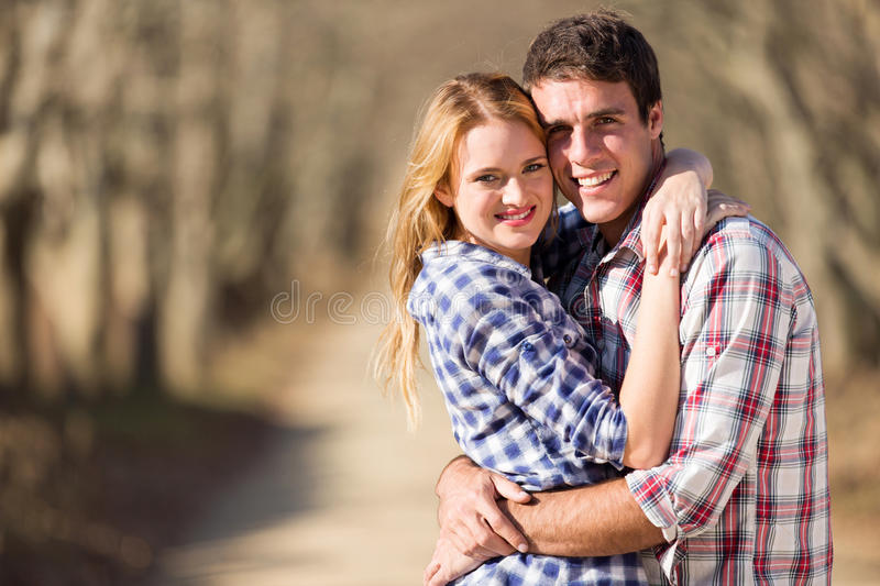 Couple hugging outdoors royalty free stock photos
