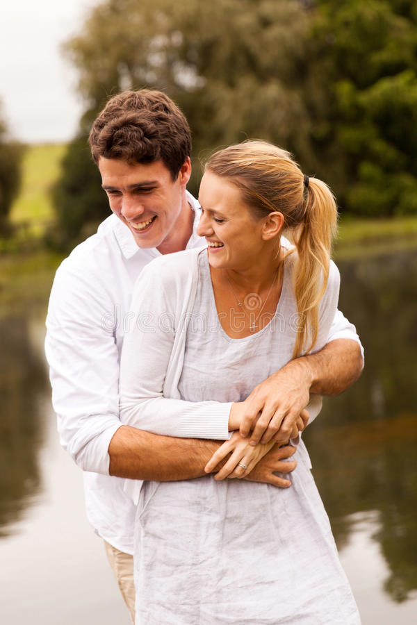 Couple hugging by the river royalty free stock photography