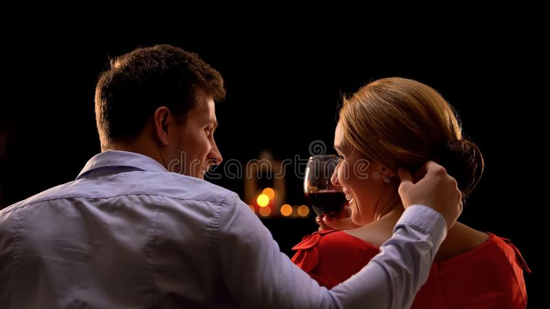Couple hugging on romantic date, enjoying time together, celebrating holiday royalty free stock images