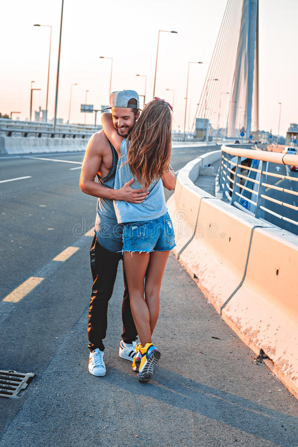 Couple hugging on the street royalty free stock photo