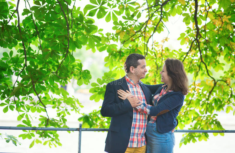 Couple hugging under a tree