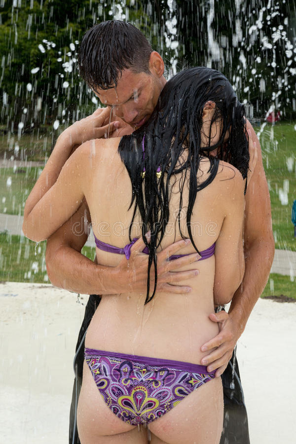Couple Hugging In A Water Park At Swimming Pool Stock Images