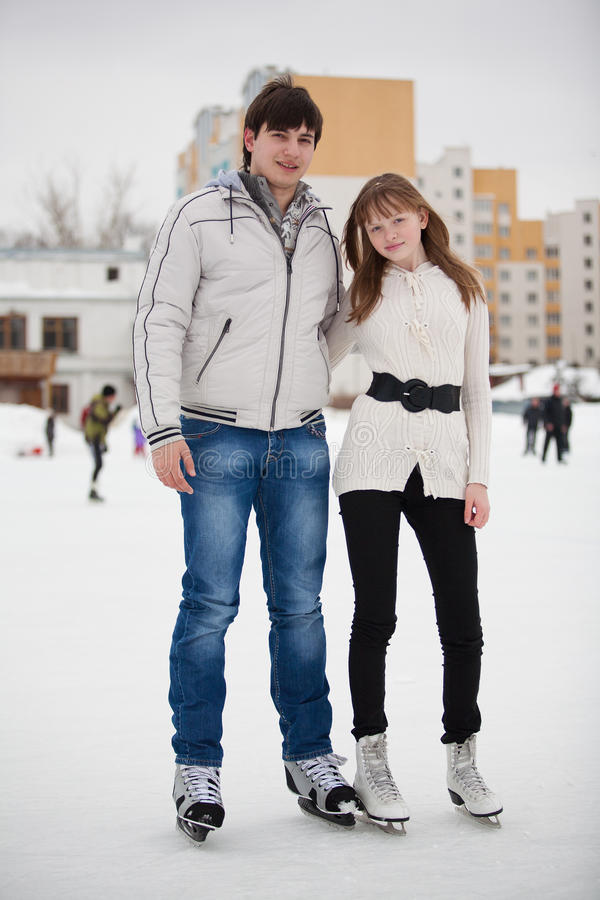 Download Couple On Ice Skate Rink Outdoors. Stock Image - Image: 23900937