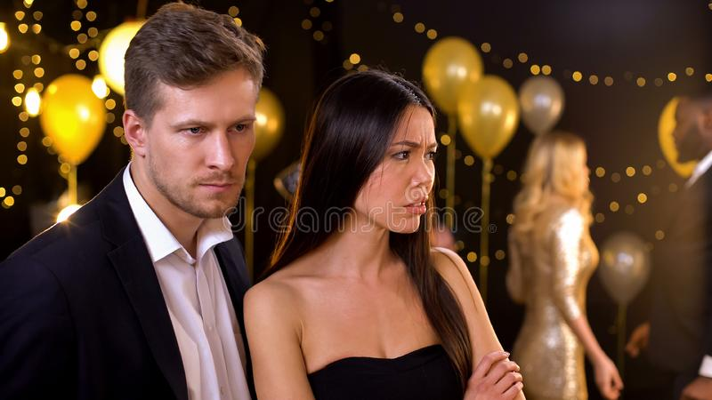 Couple ignoring each other in night club, conflict based on jealousy, betrayal. Stock photo stock photo