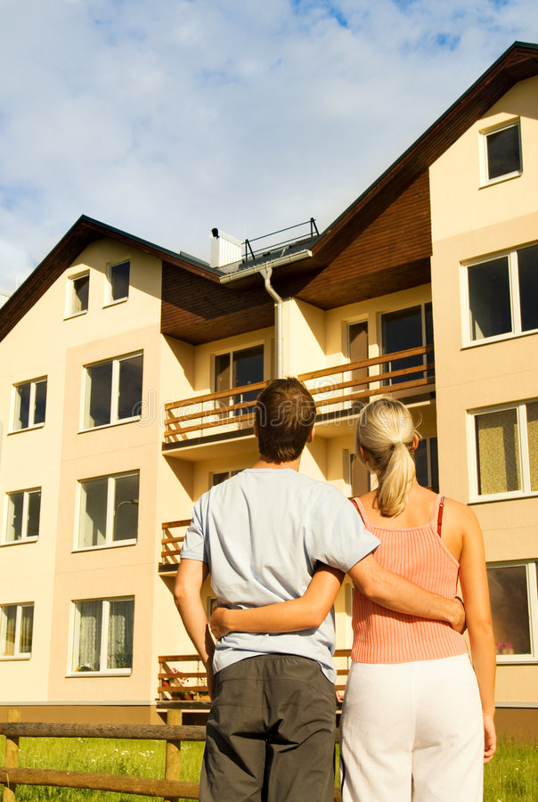 Free Couple In Front Of The House Stock Images - 5824854