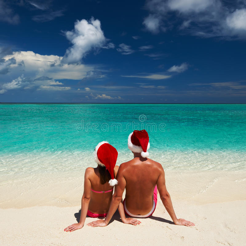 Free Couple In Santa S Hat On A Beach At Maldives Royalty Free Stock Photo - 31583455