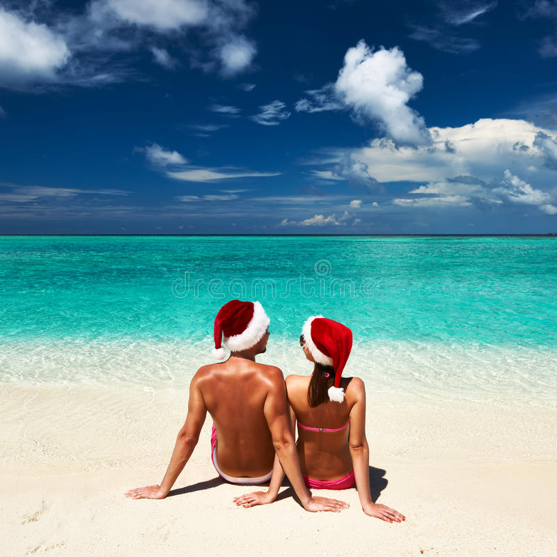 Free Couple In Santa S Hat On A Beach At Maldives Stock Photos - 33555773