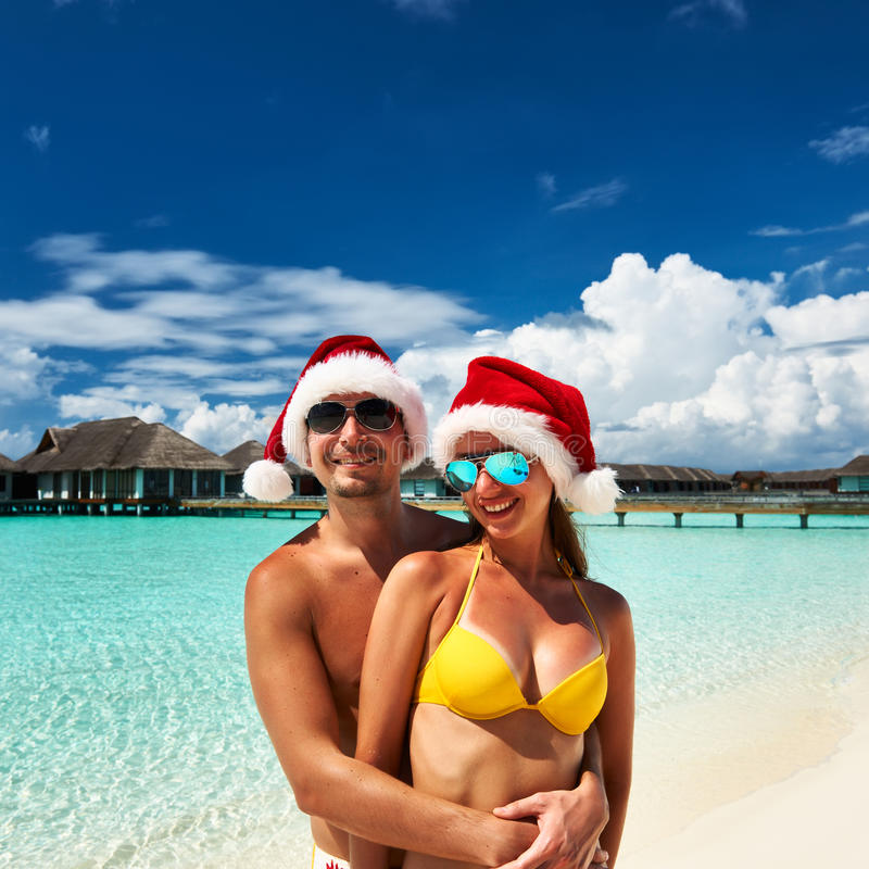 Free Couple In Santa S Hat On A Beach At Maldives Stock Images - 33714654