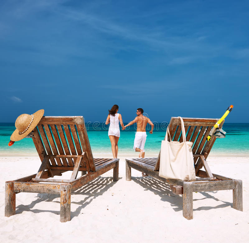 Free Couple In White Running On A Beach At Maldives Royalty Free Stock Photography - 38009957