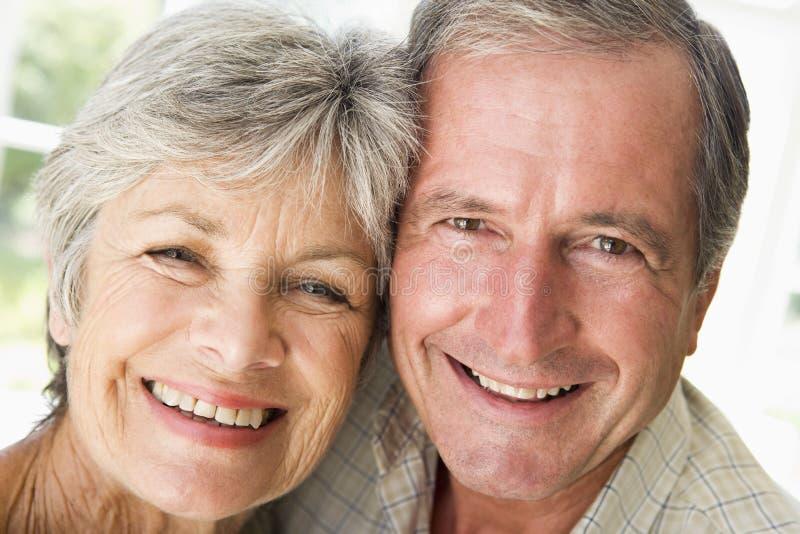 couple indoors relaxing smiling στοκ φωτογραφίες