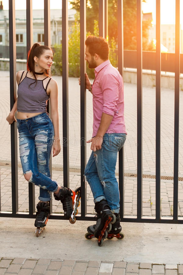 Couple on inline skates standing. royalty free stock photography