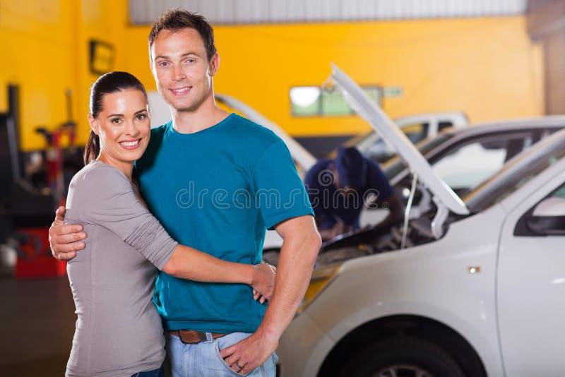 Couple inside garage stock photography