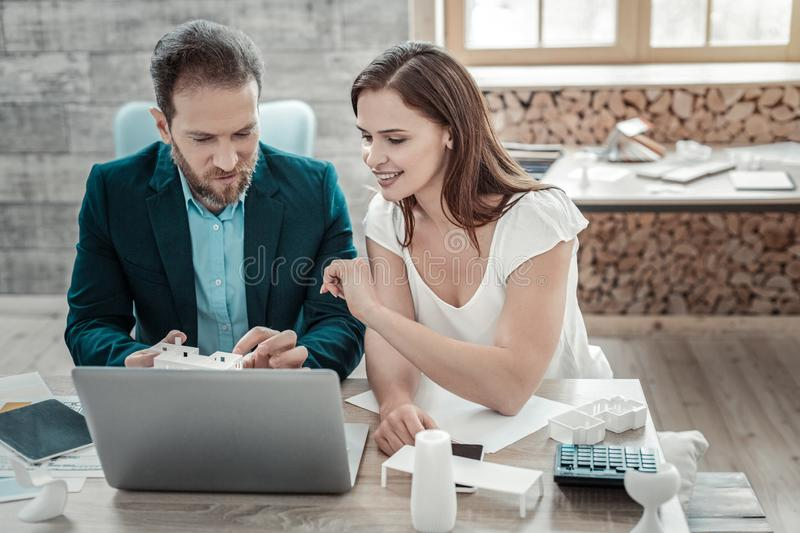 Couple of interior designers sitting in front of laptop together royalty free stock photography