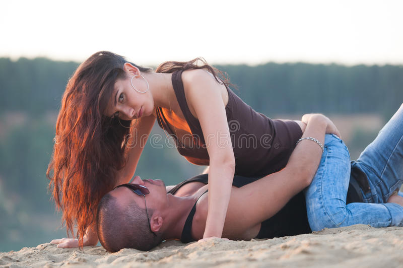Couple in jeans on the beach royalty free stock photo
