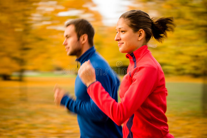 Couple jogging in nature - motion blur stock photography