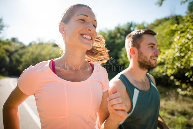 Couple jogging together stock photography