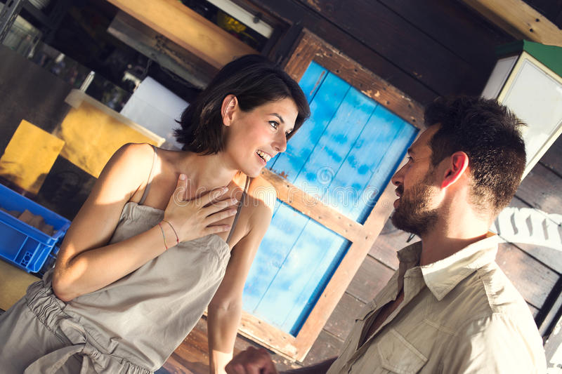 Couple jokes at the restaurant by the lake. Couple in love jokes at the restaurant by the lake stock photography