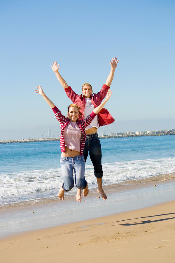 Download Couple jumping stock image. Image of dance, friends, beach - 10042913
