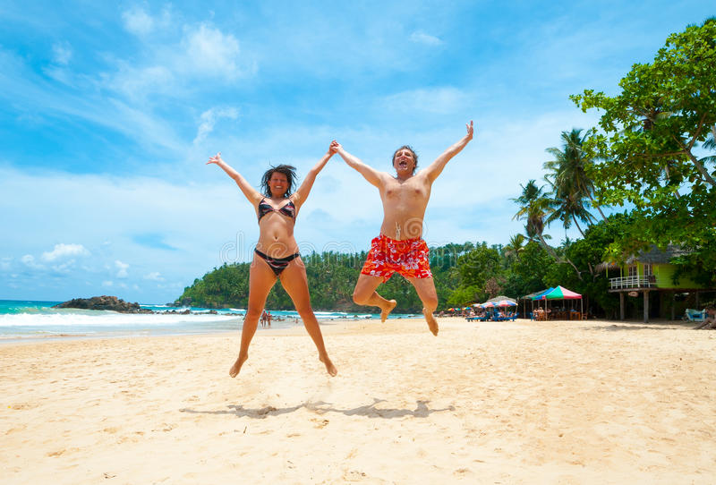Download Couple jumping on a beach stock image. Image of jump - 26338389