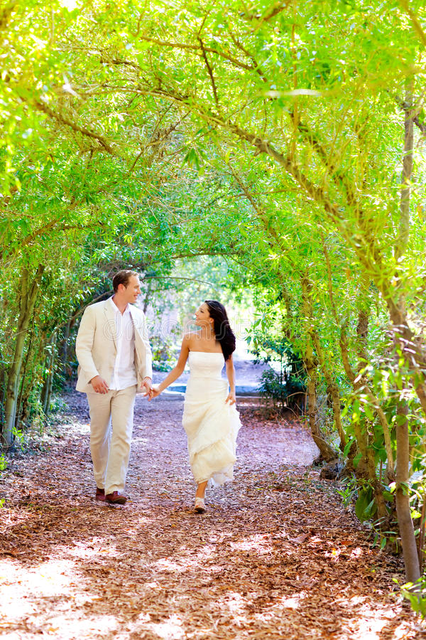Couple just married happy running in green park royalty free stock images