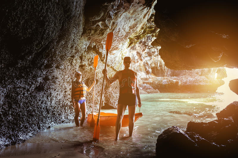 Couple of kayakers in sea cave royalty free stock images