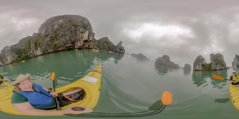 Couple kayaking in Ha Long Bay Vietnam stock images