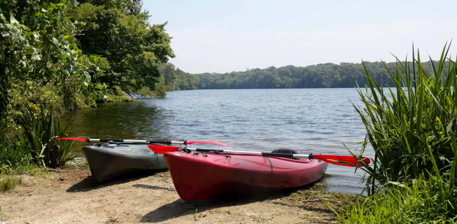 Long Island New York couple of kayaks. Couple of kayaks on lake ready for trip ,weather is great and nature around quit and beautiful royalty free stock photos