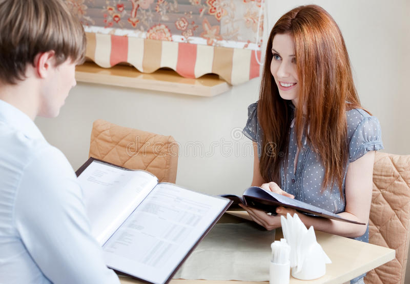 Download Couple Keeps The Menu To Make An Order Stock Photo - Image: 26410904