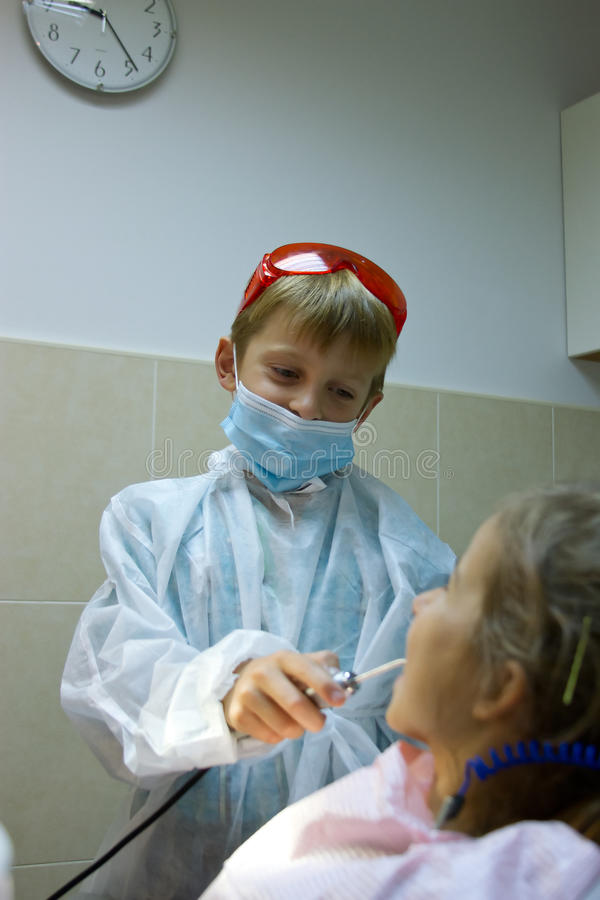 Couple of kids playing doctor at the dentist royalty free stock images