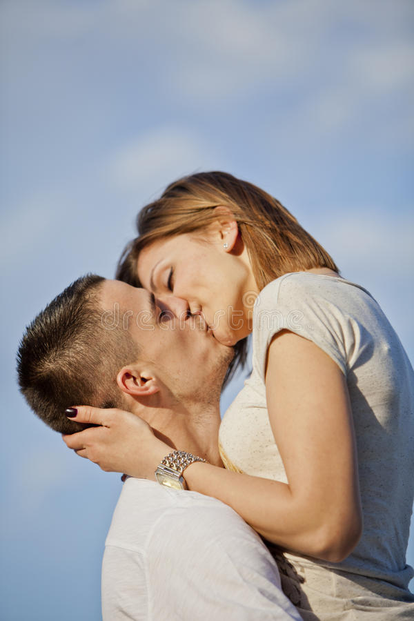 Couple kissing. Young couple in love kissing royalty free stock photography