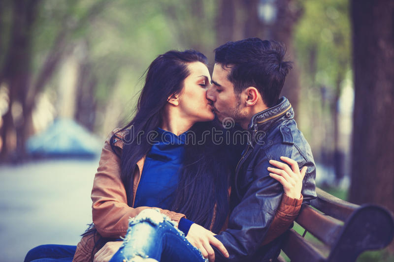 Couple kissing. At alley in city stock photo