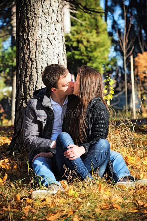 Download Couple Kissing Autumn Afternoon In The Park Stock Photo - Image: 22417156