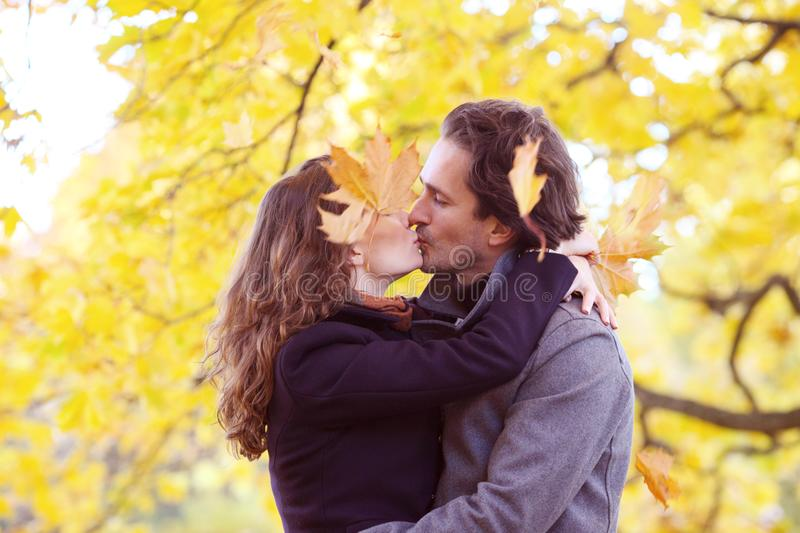 Couple kissing in autumn forest stock photos