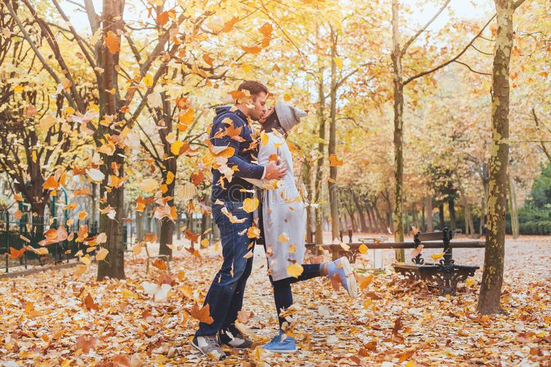 Couple kissing in autumn park, fall stock image