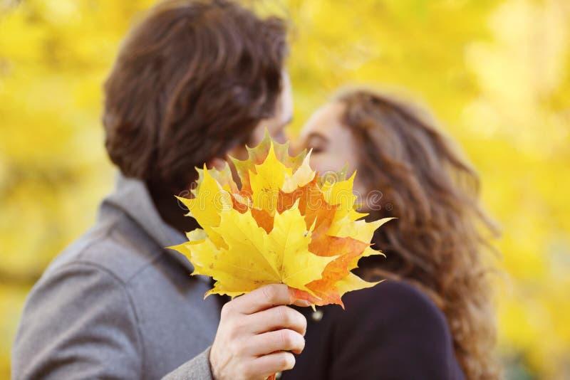 Couple kissing in autumn park stock photo