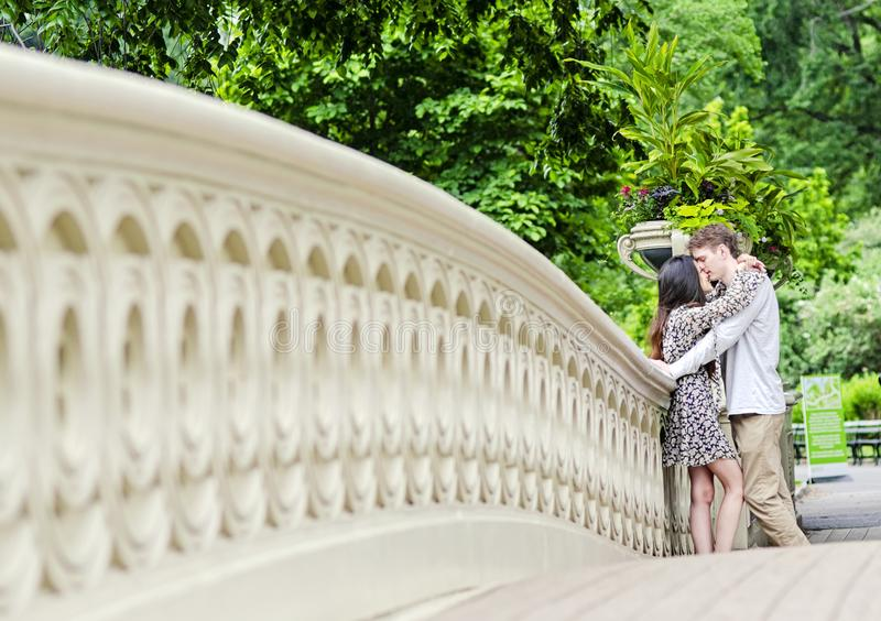 Couple kissing in Central Park in New York City royalty free stock photos