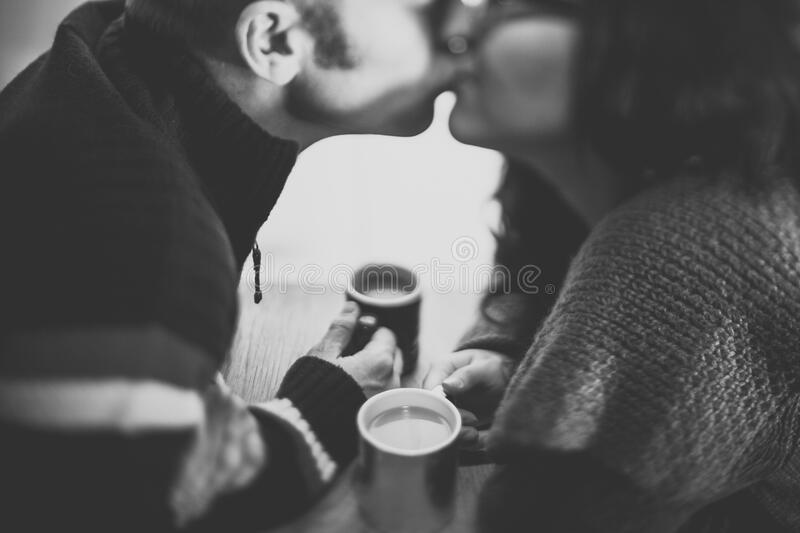 Couple kissing with coffee royalty free stock image
