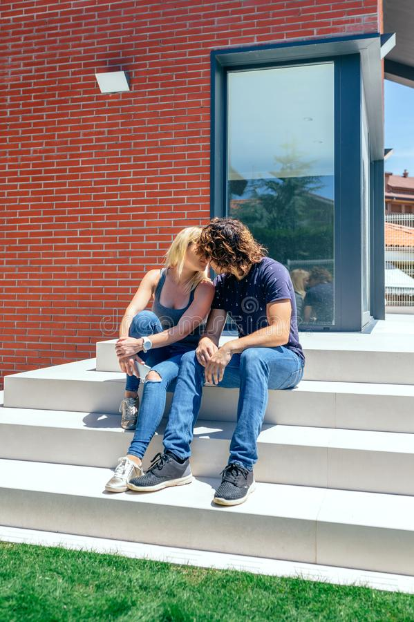 Couple kissing in front new house stock images