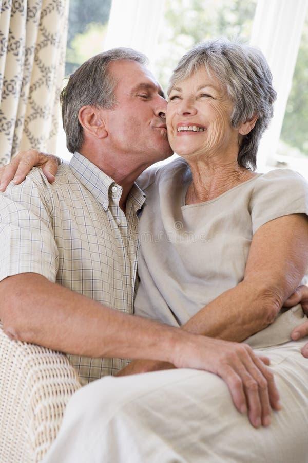 couple kissing living relaxing room smiling στοκ εικόνες