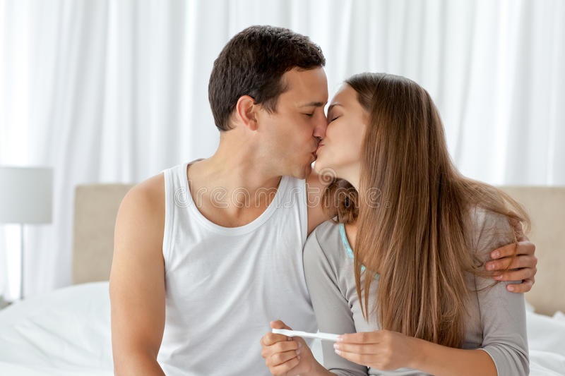 Couple Kissing After Looking At A Pregnancy Test Stock Images