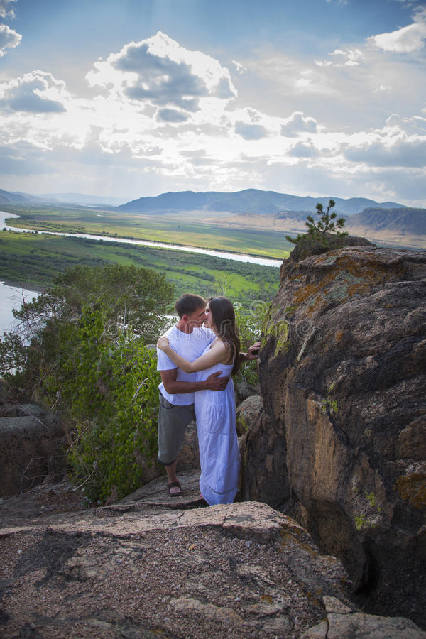 Couple Kissing In Mountains Stock Photo