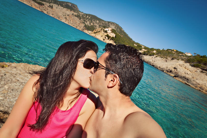 Couple Kissing Beside Sea in an Old Dock. Mallorca stock photography
