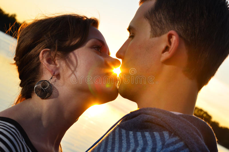 Couple Is Kissing At Sunset Royalty Free Stock Photo