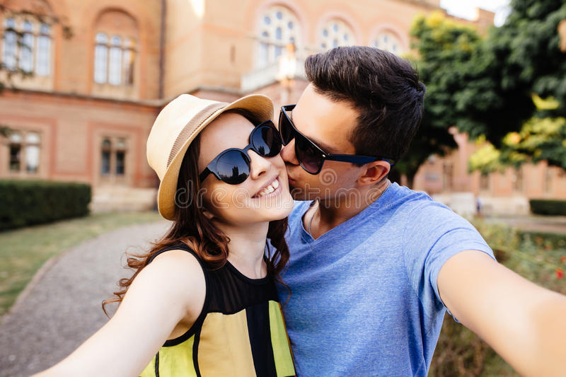 Couple kissing and taking selfie stock images
