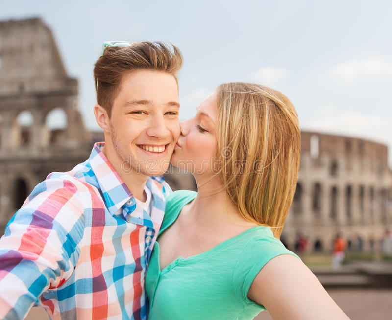 Couple kissing and taking selfie over coliseum stock image